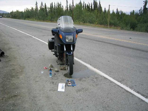 How should I prop up the bike to remove both wheels? Alaska.rock